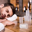 Drunk man leaning at bar counter — Stock Photo #49601917