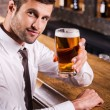 Man in shirt and tie toasting with beer — Stock Photo #49602149