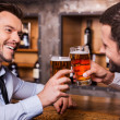 Men with beer at the bar counter — Stock Photo #49602327