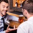 Men drinking beer at the bar counter — Stock Photo #49602399