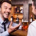 Men spending Friday night in bar. — Stock Photo #49602431