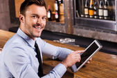 Businessman in bar. — Stock Photo
