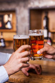 Men toasting with beer — Stock Photo