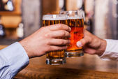 Men in shirts toasting with beer — Stock Photo