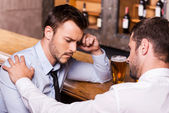 Man being consoled by his friend — Stock Photo