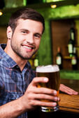 Man toasting with beer — Stock Photo