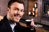 Man in formalwear drinking coffee — Stock Photo