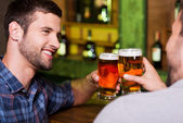 Young men toasting with beer — Stock Photo