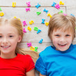 Children with plastic colorful letters — Stock Photo #49634135