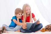 Children reading book together — Stock Photo