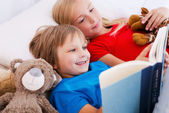 Children reading book — Stock Photo