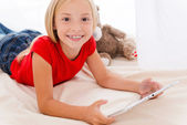 Little girl holding digital tablet — Stock Photo