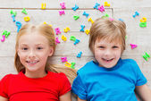 Children with plastic colorful letters — Stockfoto