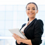 Woman in formalwear holding digital tablet — Stock Photo #49704571