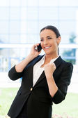 Woman in formalwear talking on the mobile phone — Stock Photo