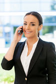Woman in formalwear talking on phone — Stock Photo