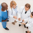 Four confident doctors discussing something — Stock Photo #49923281