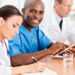 African doctor with his colleagues — Stock Photo #49924507