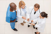 Four confident doctors discussing something — Stock Photo