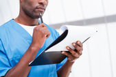Surgeon with clipboard. — Stock Photo