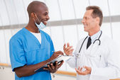 Confident doctors discussing something — Stockfoto