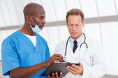 Confident doctors discussing something — Stock Photo