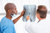 Doctors consulting about x-ray. — Stock Photo