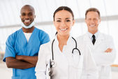 Young female doctor leading her team. — Stock Photo