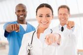 Cheerful doctors pointing you — Stock Photo
