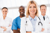 Female doctor and team. — Stock Photo
