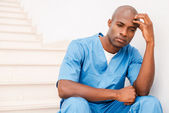 African doctor feeling tired and depressed. — Stock Photo