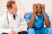 Doctor consoling his colleague. — Stock Photo