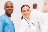 Young and confident doctors. — Stock Photo