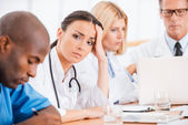 Female doctor feeling exhausted. — Stock Photo