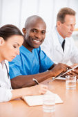 African doctor with his colleagues — Stock Photo