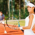Smiling woman holding tennis racket — Stock Photo #50249597