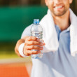 Man stretching out bottle with water — Stock Photo #50249653