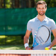 Young man holding tennis racket and ball — Stock Photo #50249825