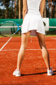 Rear view of beautiful woman in sports clothing — Stock Photo