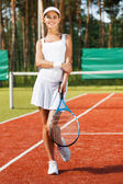 Smiling woman in sports clothing — Stock Photo