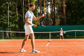 Man and woman playing tennis — Stock Photo