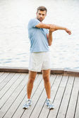 Handsome young man exercising — Stock Photo