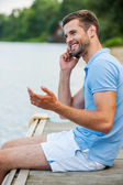 Young man talking on mobile phone — Stock Photo