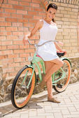 Young woman with vintage bicycle — Stock Photo