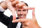 Businessman gesturing finger frame — Stock Photo
