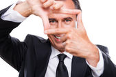 Businessman gesturing finger frame — Stock Photo