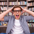 Shocked young man shouting — Stock Photo #50630479