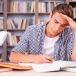 Young man making research — Stock Photo #50630601