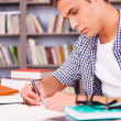 Confident young man making research — Stock Photo #50630655