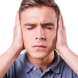Depressed man covering ears with hands — Stock Photo
